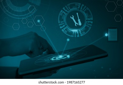 Abstract visualization of Industry Internet of Things (IIoT) or Industry 4.0. Representation of predictive maintenance as part of asset management. Hand holding tablet, security and gears.