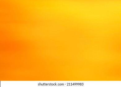 abstract warm yellow background motion blur