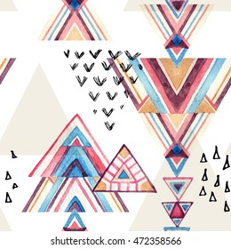 Abstract watercolor geometric seamless pattern. Triangles with aztec ornament, watercolor and grunge textures. Geometrical background in tribal style. Hand painted ethnic illustration