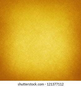 abstract yellow background or gold Christmas background with bright center spotlight, vintage grunge background texture, gold Christmas paper layout design for luxury holiday background ad