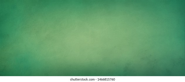 Abstract yellow green background with soft bright center glowing with light colors and dark blue green border with old vintage grunge texture