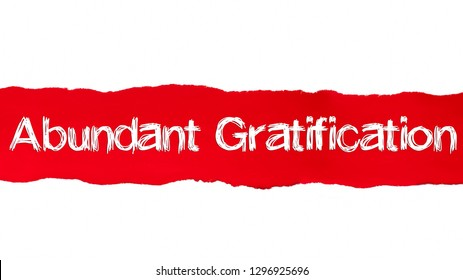 Abundant Gratification text, Inspiration and positive vibes concept on Red torn paper.