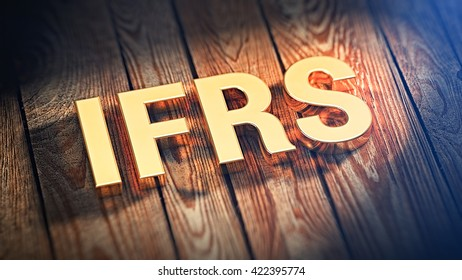 "The acronym ""IFRS"" is lined with gold letters on wooden planks. 3D illustration image"
