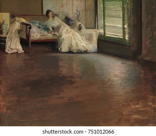 ACROSS THE ROOM, by Edmund Charles Tarbell, 1899, American painting, oil on canvas. A reclining young woman is painted from across a wide, polished floor. Impressionist technique is seen in the play o