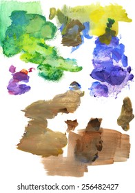 Acrylic paints in purple, blue, green, yellow and brown, on a white paper palette.