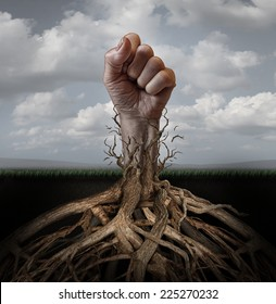 Addiction freedom and breaking out concept as a human hand in a fist escaping from tree roots holding it down as a symbol for human rights and fighting for individual independence and liberation.