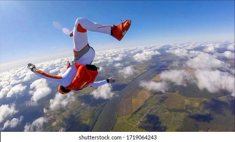 Adrenaline. Extreme sky for free people. No rules in open air. Parachutist in professional suit is in free fall. Skydiving is a sport of the future.