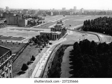 Aerial view of Brandenburg Gate where the Berlin Wall forms a loop East Berlin stretches into the distance.