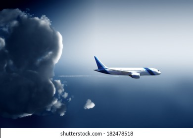 Airliner shape escapes from a storm cloud in widescreen view