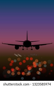 airplane on the background lights of the night city bokeh effect top view at sunset