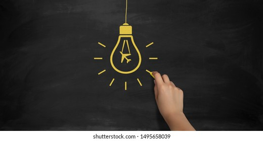 Airplane symbol bulb drawing with a yellow chalk on blackboard by a female hand. 3D rendering.