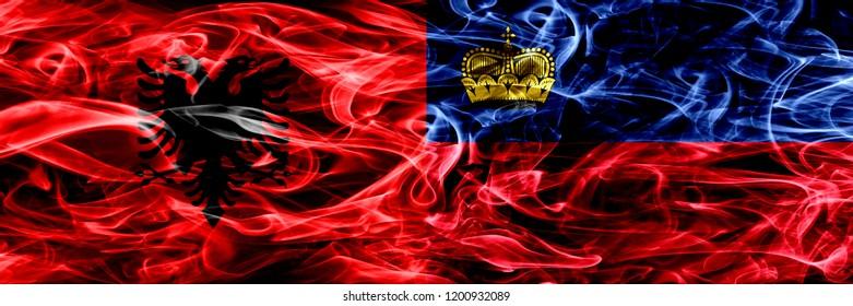 Albania vs Liechtenstein, Liechtensteins smoke flags placed side by side. Thick colored silky smoke flags of Albanian and Liechtenstein, Liechtensteins