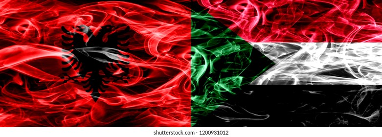 Albania vs Sudan, Sudanese smoke flags placed side by side. Thick colored silky smoke flags of Albanian and Sudan, Sudanese