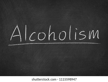 alcoholism concept word on a blackboard background