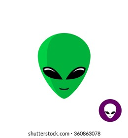 Alien face logo. Planet UFO intruder with big green head and huge deep black eyes. Flat style mask.