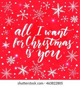 All I want for Christmas is you. Inspirational quote for Christmas cards and greetings. Modern calligraphy phrase on red background with white snowflakes