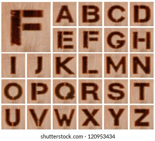 Alphabet - Collection of Letters Burnt in Wood - Isolated on White