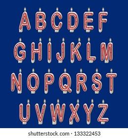 Alphabet set. Lit holiday candles against blue background