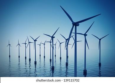Alternative energy- shot of floating wind turbine farm during foggy day.