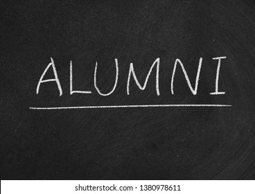 alumni concept word on a blackboard background