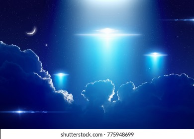 Amazing fantastic background - extraterrestrial aliens spaceships, ufo with bright spotlight in dark blue starry sky. Elements of this image furnished by NASA