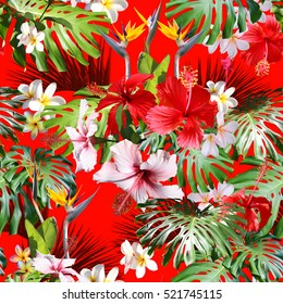Amazing tropical print hawaiian shirts and textile floral design. Floral pattern tropical background seamless on a red background with blossom hibiscus and plumeria. Photo collage plants.