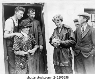 Amelia Earhart (1897-1937), with Mr. & Mrs. Laughlin (left), in Culmore, Northern Ireland. The first people she encountered after her solo trans-Atlantic flight ended in an Irish pasture. May 1932.