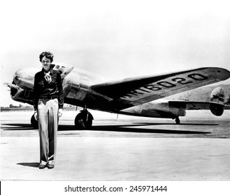 Amelia Earhart standing in front of the Lockheed Electra in which she disappeared in July 29, 1937.