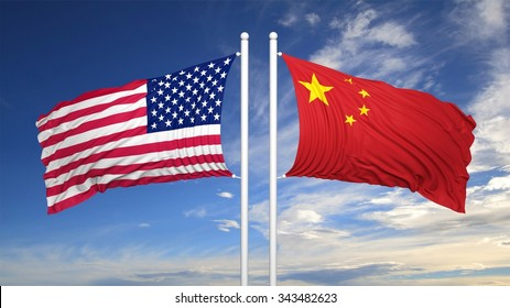 American and Chinese flags against of blue sky