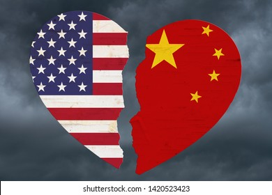 American and Chinese flags in a broken heart with stormy sky background 3D Illustration