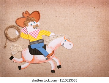 American Cowboy in american wild west hat with cowboy lasso ride a horse.Paper cut application