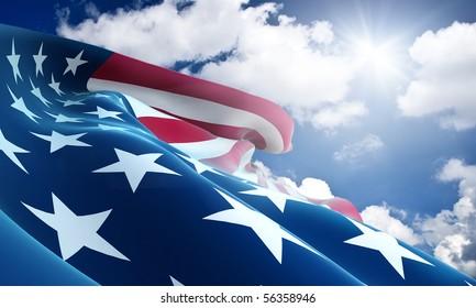American flag closeup on blue sky