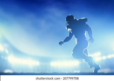 American football player in game, running. Night stadium lights