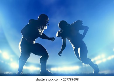 American football players in game, quarterback running. Night stadium lights