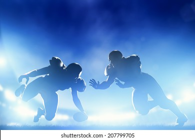 American football players in game, touchdown. Night stadium lights