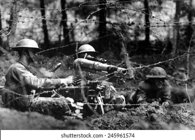 American soldiers firing a French 37 mm artillery gun in second-line trench. This WWI cannon had a maximum range of a mile and a half. Dieffmatten, Germany. June 26, 1918.