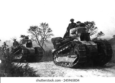 American troops ride on WWI tanks going forward to the battle line in the Forest of Argonne, France. Sept. 26, 1918.