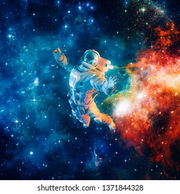 Among the stars / 3D illustration of science fiction scene with astronaut floating in outer space amid glowing colourful galaxies