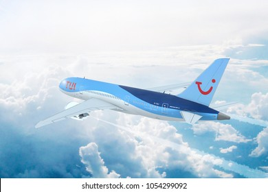 AMSTERDAM - MARCH 22, 2018: Aerial in-flight view of TUI Airways (Thomson Airways) Boeing 787 Dreamliner flying high above the clouds. 3D Illustration.