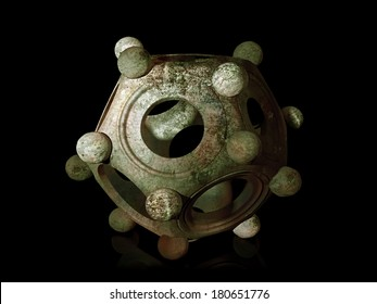 Ancient bronze Roman dodecahedron on a black background