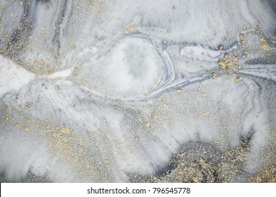 Ancient oriental drawing technique. Golden powder and blue paint. Abstract art wallpaper.  Marble texture. Eastern style. Beautiful pattern.Oriental art. Marbling background. Pastel tones.