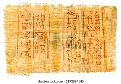 Ancient papyrus with Egyptian hieroglyphs: the names of the goddess of Isis (left) and the god of the Underworld of Osiris (right).  Manuscript from The Karnak temple, Thebes valley, Luxor, Egypt.