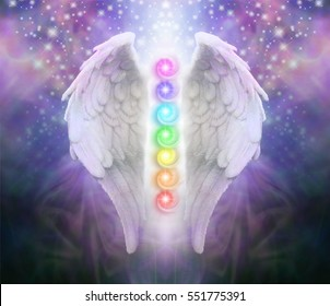 Angel Wings Chakras Darkness and Light - A pair of Angel wings with the seven chakras between with dark blue black and purple behind, a shaft of light and sparkles