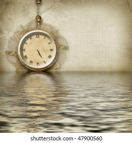 Antique clock face reflected in the water
