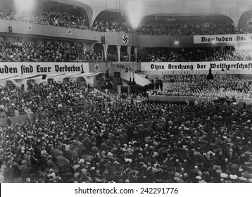 Anti-Semitic rally, with swastikas and anti-Semitic banners, at the massive auditorium of Sportpalast, Berlin, where Nazi propagandist, Julius Streicher, would speak on August 16, 1935.