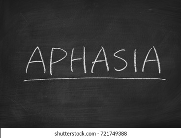 aphasia concept word on a blackboard background