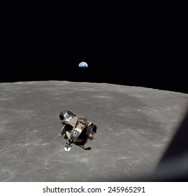The Apollo 11 Lunar Module ascending from Moon's surface. In the background is Mare Smythii with the Earth on horizon. July 20, 1969.