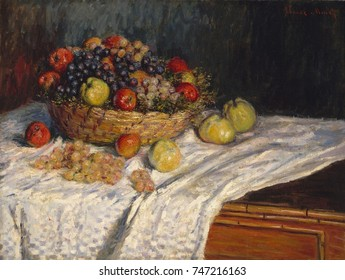 Apples and Grapes, by Claude Monet, 1879_80, French impressionist painting, oil on canvas. In painting this basket of apples, Monet balances the active surface created by his small brushstrokes with t