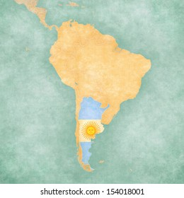 Argentina (Argentine flag) on the map of South America. The Map is in vintage summer style and sunny mood. The map has a soft grunge and vintage atmosphere, which acts as a watercolor painting.