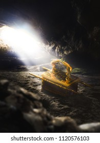Ark of the covenant in a cave with light rays / 3D Rendering